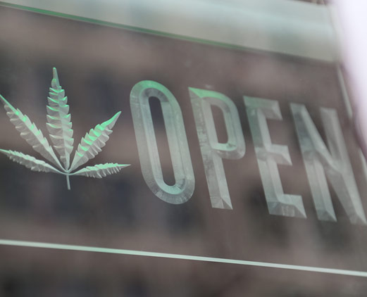 marijuana leaf displayed on open sign