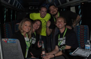 Smiling group of friends on the 420 friendly bus