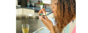 Lady smoking cannabis in nice kitchen