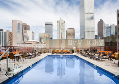 Beautiful outdoor seasonal pool with views of downtown Denver